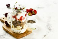 Healthy layered dessert in the jar stock photos