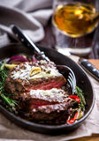 Healthy lean grilled medium-rare steak and vegetables. With whiskey glass and a spice in a rustic pub or tavern. Food-styling stock photos