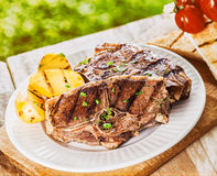 Healthy lean lamb chops with grilled potato Stock Image