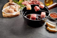 Healthy lean meat being cooked in a fondue Royalty Free Stock Photography