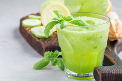 Healthy lemonade with cucumber, basil, lemon, honey and sparkling water, horizontal, copy space Royalty Free Stock Images