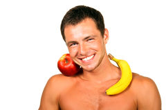 Healthy life. Healthy man with an apple and banana stock photography