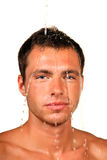 Healthy life. Young good looking and attractive man with muscular body wet royalty free stock photography