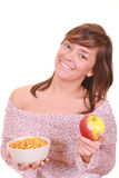 Healthy life. Young beautiful woman with bowl of cereals and apple - healthy life - isolated on white Stock Photos