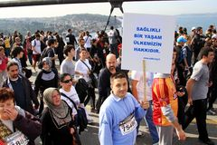 Healthy life. Sportsman demonstrates healthy life banner during the 32nd Intercontinental Eurasia Marathon run on October 17, 2010 in Istanbul, Turkey Stock Images