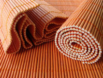 Healthy Life: Bamboo Placemats. Healthy Life: Orange Bamboo Placemats. One rolled up and one bent Royalty Free Stock Image