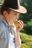 Healthy life boy eating apple. Diet and Nutrition -A boy eating a fresh apple in the countryside Royalty Free Stock Photos