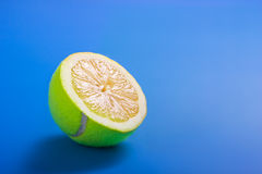 Healthy life concept with sliced tennis ball and lemon Royalty Free Stock Images