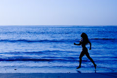 Healthy life concept - woman running at beach Royalty Free Stock Images