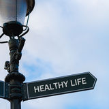 HEALTHY LIFE directional sign on guidepost Royalty Free Stock Photo