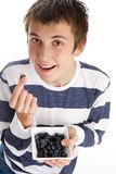 Healthy life - eating blueberries Stock Photos
