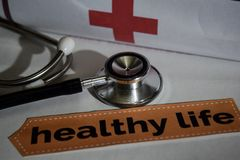 Healthy life message with stethoscope, health care concept. stock image