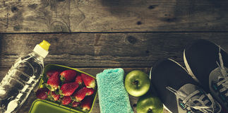 Healthy Life Sport Concept. Sneakers with Apples, Towel and Bott Royalty Free Stock Photo