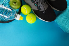 Healthy Life Sport Concept. Sneakers with Tennis Balls, Towel an Royalty Free Stock Photo