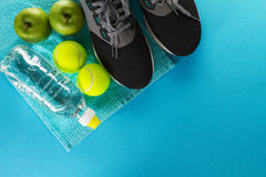 Healthy Life Sport Concept. Sneakers with Tennis Balls, Towel an Stock Photo