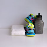 Healthy life and sport workout concept. Sneakers, running shoes, bottle of water, socks, towel Royalty Free Stock Photos