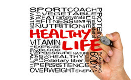 Healthy life word cloud handwritten on whiteboard Royalty Free Stock Images