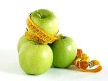 Healthy lifestyle. Close up of three green apples and a tape. Concept of healthy lifestyle Royalty Free Stock Photos