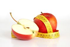 Healthy lifestyle. Close up of two red apples and a tape. Concept of healthy lifestyle Royalty Free Stock Images