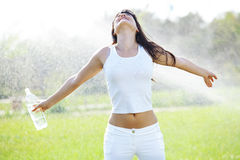 Healthy lifestyle. Portrait of young woman drinking water at green park Royalty Free Stock Image