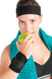 Healthy Lifestyle. Woman about to eat a green apple after her workout at the gym Royalty Free Stock Photos