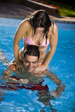 Healthy lifestyle. Couple having fun at the swimming pool Royalty Free Stock Photo