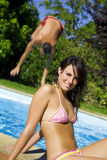 Healthy lifestyle. Young woman at the swimming pool Royalty Free Stock Photo