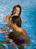 Healthy lifestyle. Couple having fun at the swimming pool Stock Image
