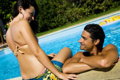 Healthy lifestyle. Couple having fun at the swimming pool Stock Photos