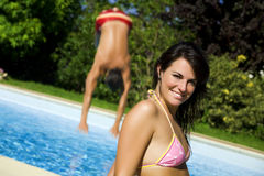 Healthy lifestyle. Young woman at the swimming pool Royalty Free Stock Images