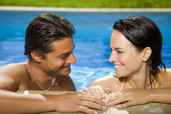 Healthy lifestyle. Couple having fun at the swimming pool Royalty Free Stock Photography
