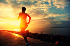 Healthy lifestyle asian woman running. Healthy lifestyle beautiful asian woman running at seaside morning Stock Image