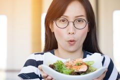Healthy lifestyle asian woman showing salad smiling. stock images