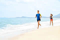Healthy Lifestyle. Athletic Couple Running On Beach. Sports, Fit Royalty Free Stock Images