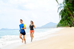 Healthy Lifestyle. Athletic Couple Running On Beach. Sports, Fit Royalty Free Stock Image