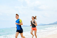 Healthy Lifestyle. Athletic Couple Running On Beach. Sports, Fit. Healthy Lifestyle. Athletic Runner Couple Running On Beach, Training For Marathon. Sporty Fit Stock Image