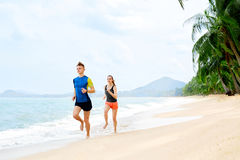 Healthy Lifestyle. Athletic Couple Running On Beach. Sports, Fit. Healthy Lifestyle. Athletic Runner Couple Running On Beach, Training For Marathon. Sporty Fit Royalty Free Stock Photo