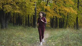 Healthy lifestyle. athletic girl running in the Park and doing exercises Jogging. stock video footage