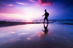 Healthy lifestyle, beach at sunset Stock Photography