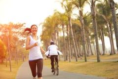 Healthy lifestyle beautiful asian woman running stock photo
