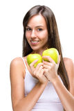 Healthy lifestyle - Beautiful, natural woman holds an two  apple Foto de Stock Royalty Free
