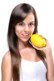 Healthy lifestyle - Beautiful pretty woman bites a lemon Imagem de Stock Royalty Free