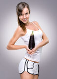 Healthy lifestyle! Beautiful woman holding  eggplant Stock Photo