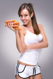 Healthy lifestyle! Beautiful woman holding lot of carrots Royalty Free Stock Photo
