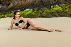 Healthy Lifestyle. Beautiful Young Woman Relaxing On Beach. Summ. Healthy Lifestyle. Beautiful  Happy Young Woman With Sexy Fit Body, Long Legs Lying ( Relaxing Stock Photos