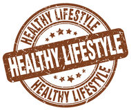 Healthy lifestyle brown grunge round vintage  stamp Stock Photography