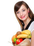 Healthy lifestyle - cheerful woman with fruit shopping paper bag Stock Photography