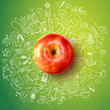 Healthy lifestyle concept with apple and doodles Stock Photo