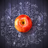 Healthy lifestyle concept with apple and doodles Royalty Free Stock Photography