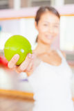 Healthy lifestyle concept with beautiful asian woman holding green apple Royalty Free Stock Photos